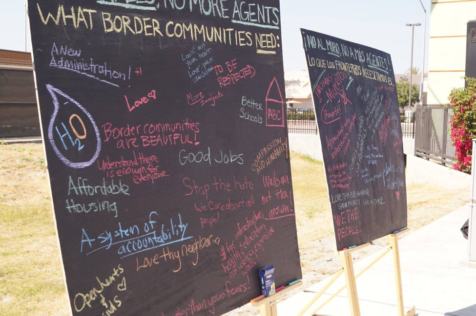 "Photo Courtesy of Alliance San Diego. Chalkboards full of visions for what border communities really need, during a ""defend DACA"" press conference in July, 2017."