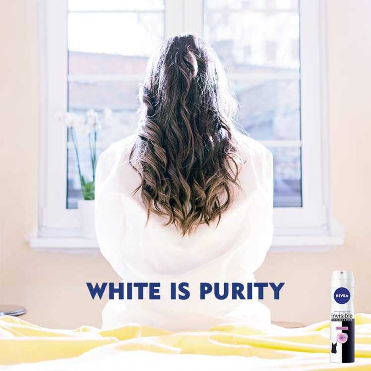 "Controversial Nivea ad that features the back of a white woman and reads ""white is purity"""